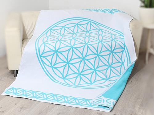 Produkt: Weiß-türkise Decke mit dem Symbol der Blume des Lebens