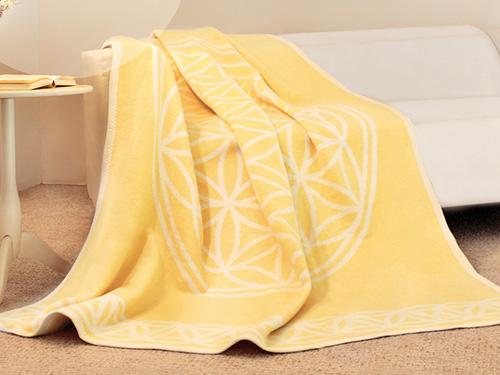 Produkt: Gelbe Decke mit dem Symbol der Blume des Lebens